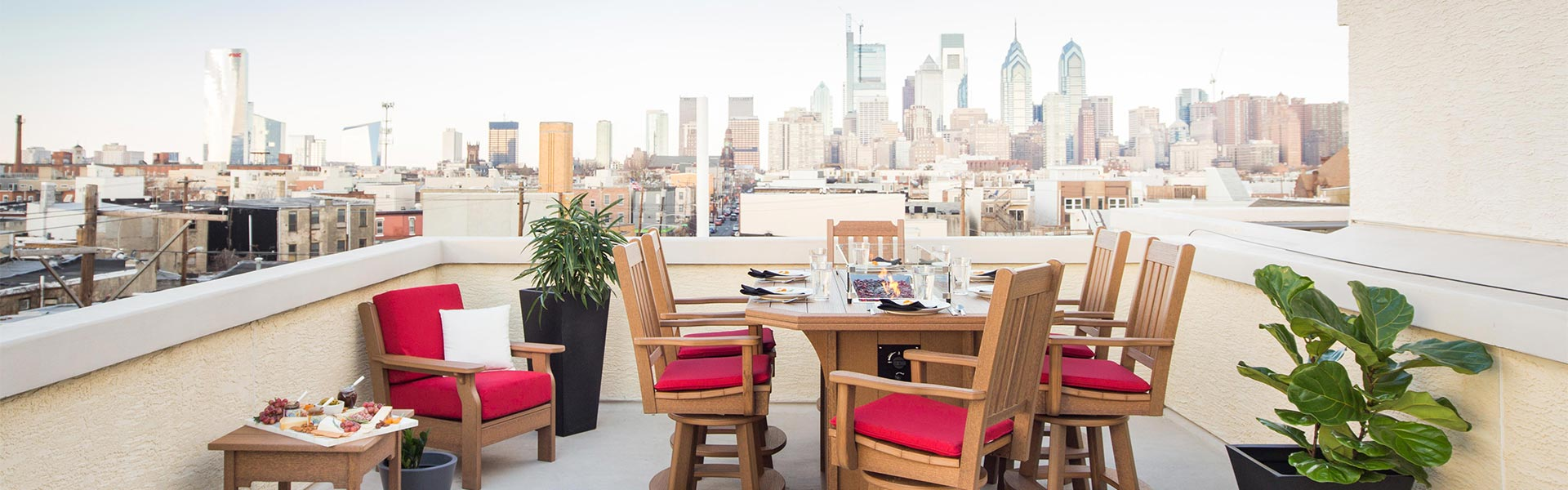 Bar height poly dining furniture set on roof top terrace