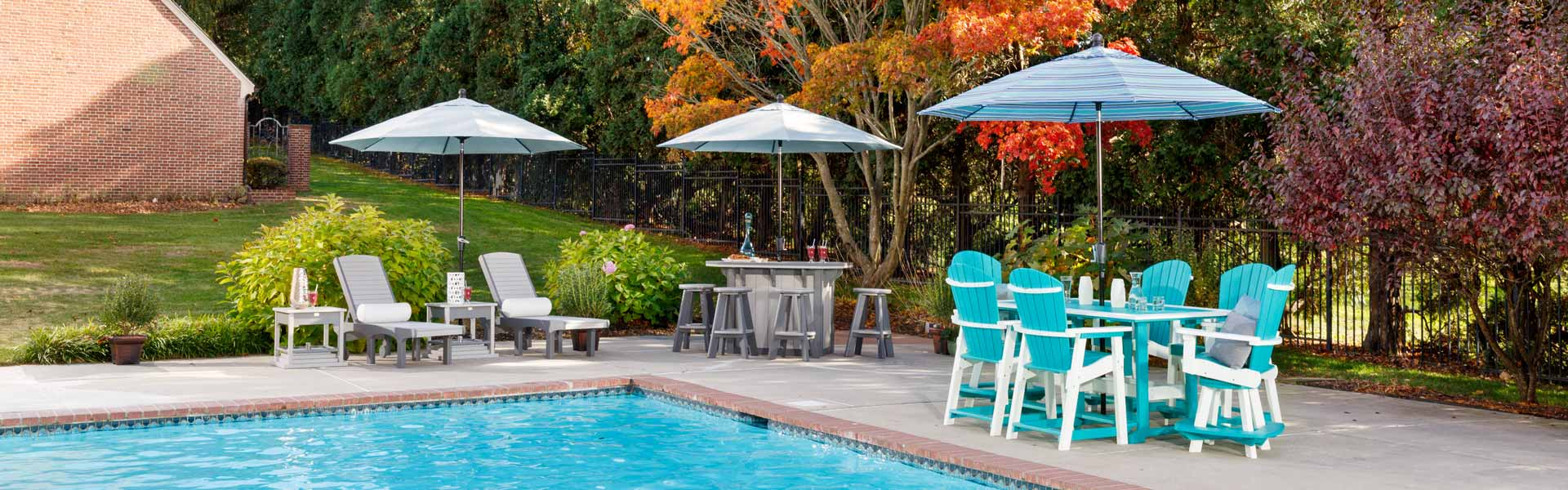 Poly furniture sets with outdoor umbrellas by pool