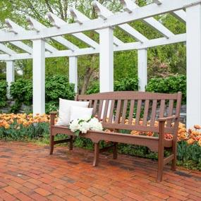 "72"" Avonlea Garden Bench on a brick patio"