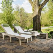 Two SunSurf Lounges on a cobble stone patio.
