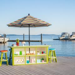 Lime Green on White 3ft x 8ft SummerSide Bar with 6 Bar Stools on a boat dock