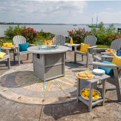 A 42 inch SummerSide Round Fire Table surrounded with 5 Great Bay dining chairs.