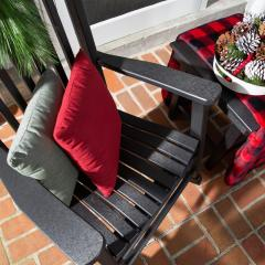 Closeup of a poly porch rocker on a porch with a Zinn's Mill Side Table