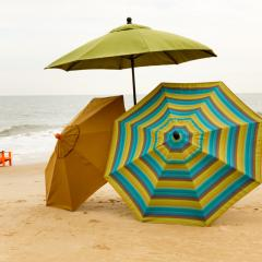 Three outdoor beach umbrellas