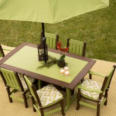 Rectangular poly dining table with six poly chairs and umbrella