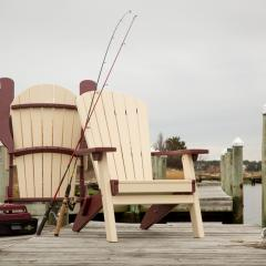 Two two-tone foldable poly adirondack chairs