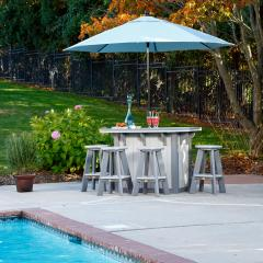 Poly bar with umbrella and four poly bar stools