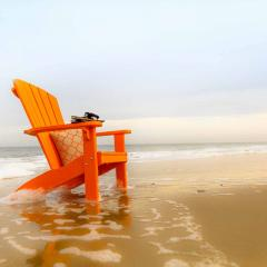 Orange Poly adirondack on beach