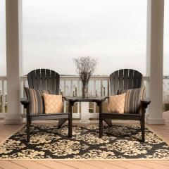 Two black poly adirondacks with tete-a-tete table