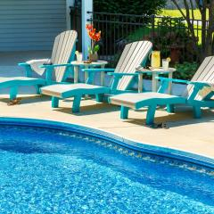 Three fanback poly lounge chairs beside pool