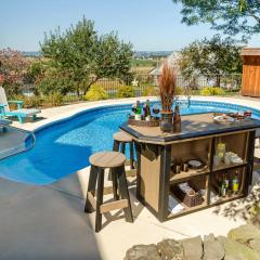 Poly bar with bar stools beside pool