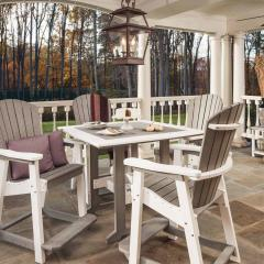Square poly dining table with four poly fanback chairs