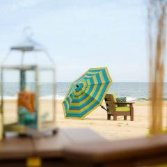 Poly chair with outdoor umbrella on beach