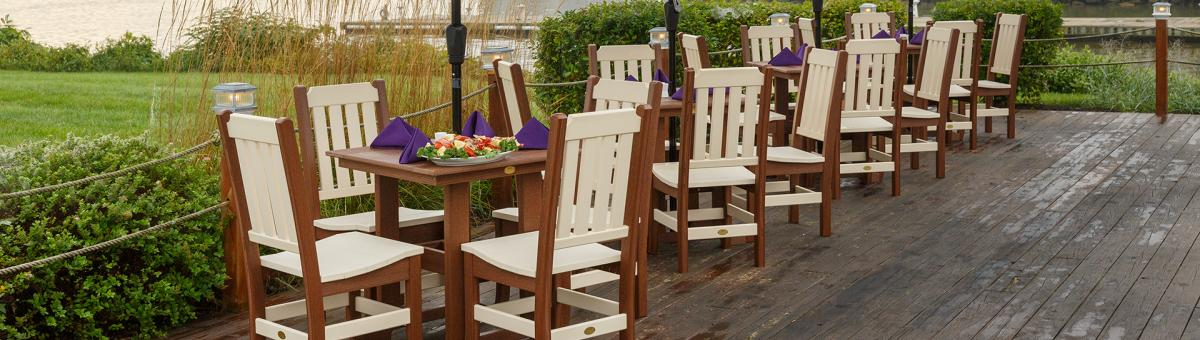 Walnut on Ivory poly colored Keystone chairs around Great Bay tables.