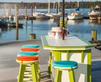Side view of the Lime Green on White 3ft x 4ft SummerSide Bar with 6 Bar Stools on a boat dock
