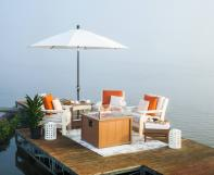Van Buren Sofa, Chairs, End Table, Umbrella Stand and a SeaAira Fire Pit on a dock.