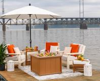 Van Buren Sofa, Chairs, End Table, Umbrella Stand and a SeaAira Ice Pit on a dock.