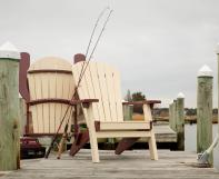 Two folding Poly Adirondack Chairs on a dock