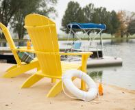 Two Yellow Poly Adirondacks on a dock