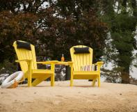 Two Yellow Poly Adirondack Chairs