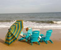Teal Blue Poly Adirondack Chairs with Sunbrella Umbrella at the beach