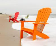 Poly Adirondack Chairs sitting in surf on the beach