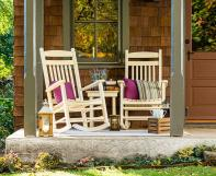 Two poly porch rockers on a porch with a Zinn's Mill Side Table