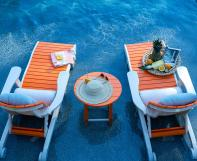 Poly Outdoor Lounge Chairs in pool water