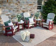 poly outdoor glider rockers and side tables on a patio