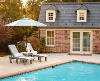 Poly poolside lounge chairs with side table and outdoor umbrella