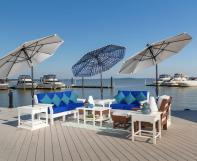 White and blue outdoor umbrellas with poly outdoor furniture